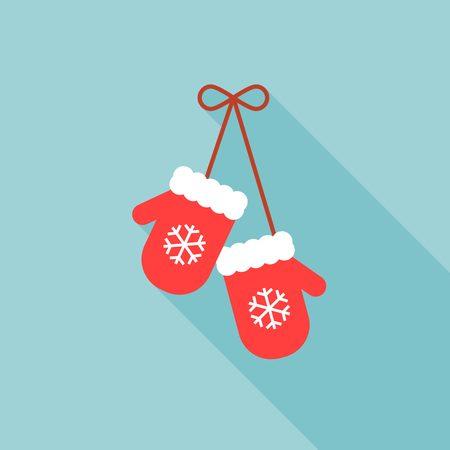 Par de manoplas de punto de Navidad con el patrón de los copos de nieve sobre fondo verde, diseño plano