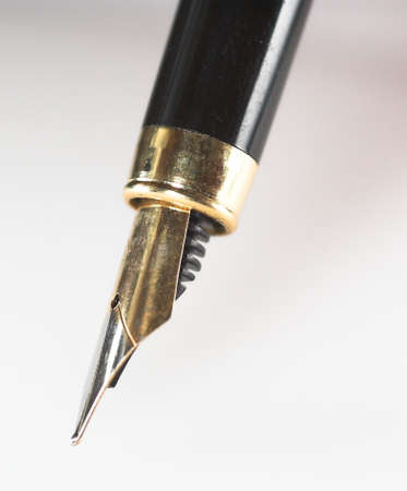 old gold black pen on withe backgraund Stock Photo