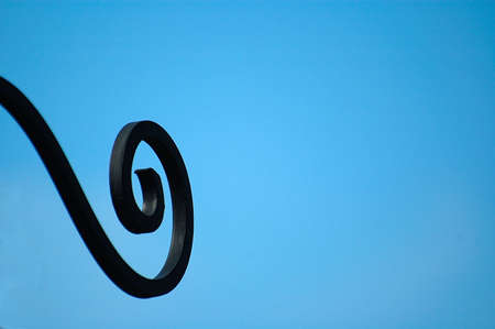 constituent: black,  blue,  component,  constituent,  curved,  element,  factor,  iron,  metal,  sky,  unit,  winding, Stock Photo