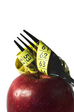 prong: apple, autumn, centimeter, centimetre, crutch, cutlery, diet, drew, drop, eat, fall, fork, fruit, loose, measure, prong, red, vitamin, water, weight, yellow,