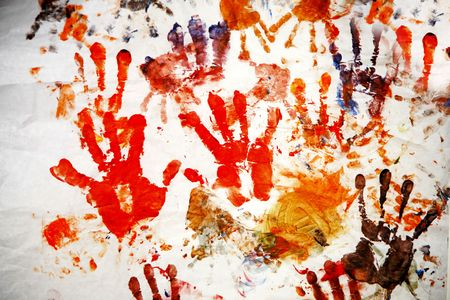 color hand prints painted on a white wall