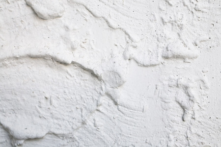 Plaster wall texture - closeup good for background Banco de Imagens