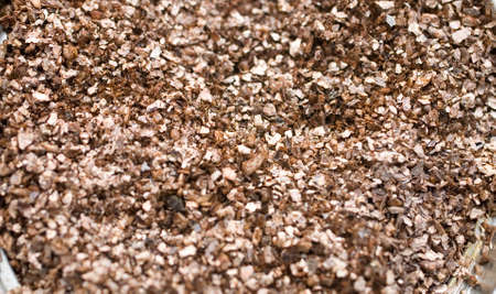 interesting background from shiny fine beige pebbles, in close-up, Stock Photo