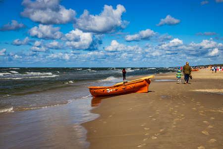 an orange lifeguard boat on a beach in �eba in Poland on a warm sunny day Foto de archivo