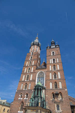 famous historic church in the old town square in krakow, poland on a summer holiday day