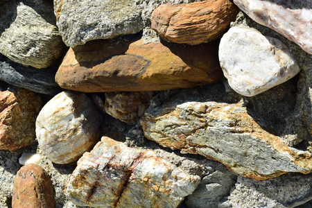 Surface stone wall background. Grey stone wall background.