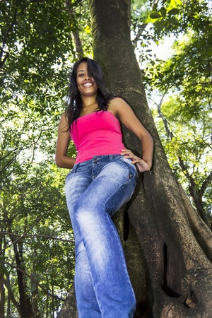 skiny: Teenage woman posing at the trees
