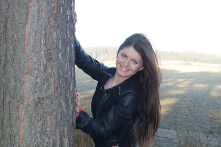 face in tree bark: A young girl and a tree