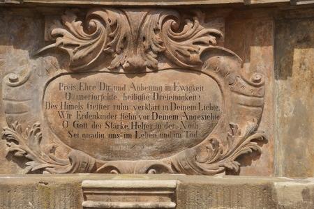 plague: Baroque inscription on the plague column Stock Photo