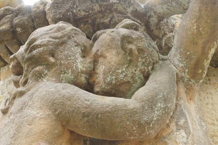 ravaged: Statue of lovers forgotten love is eternal Stock Photo