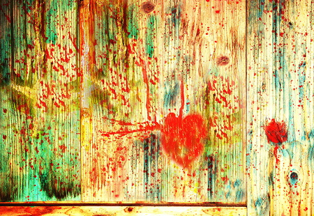 wounded: Wounded bleeding heart on a wooden board Stock Photo