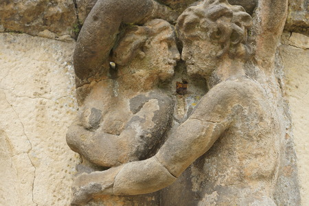 damaged: surface damaged statues of lovers