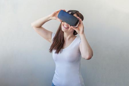 visualizing: Woman using VR headset Stock Photo