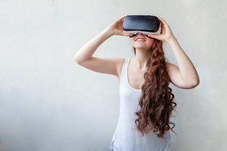 virtual reality simulator: Woman using VR headset Stock Photo