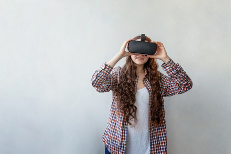 Woman using VR headset Stock Photo