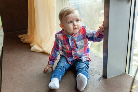 establish: Baby smiles in a room near the window Stock Photo