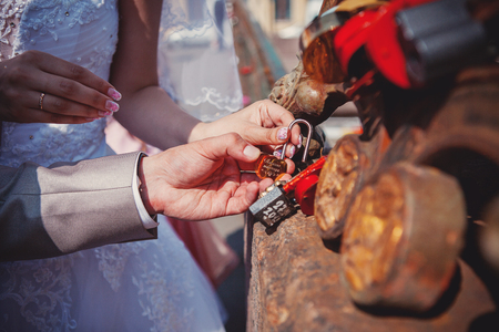 The lock in hands of newlyweds Stock Photo