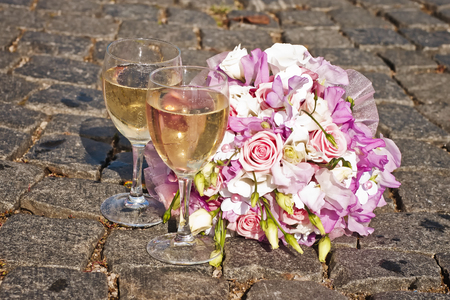 glass reflection: brides bouquet and champagne glasses Stock Photo