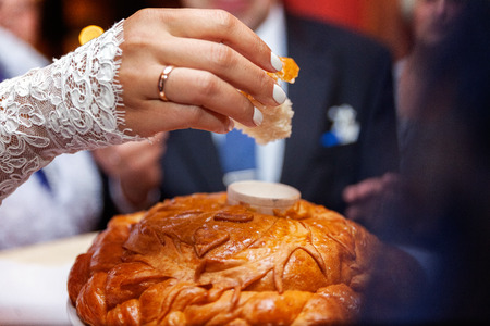 wedding loaf being broken by bride and groom Stock Photo