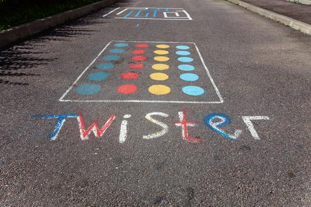 fitness equipment: childrens game twister on the asphalt Stock Photo