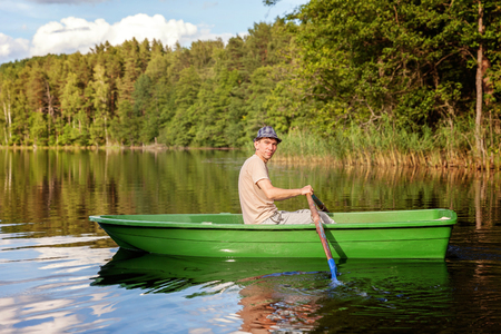 A fisherman in a boat