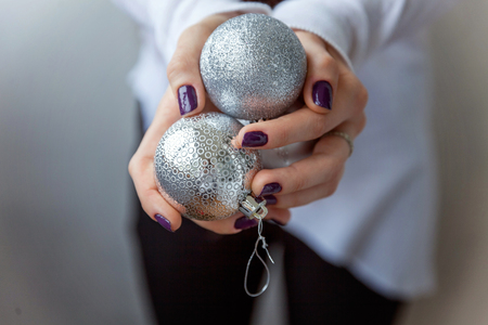 Christmas balls in the hands
