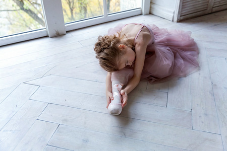 young ballet-dancer sitting on the floor