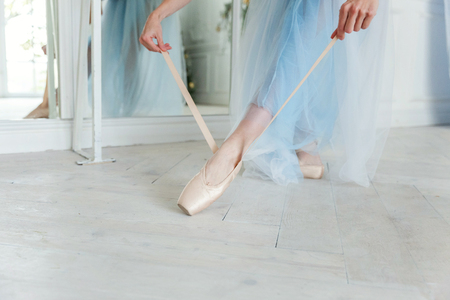 Ballerina puts pointe shoes