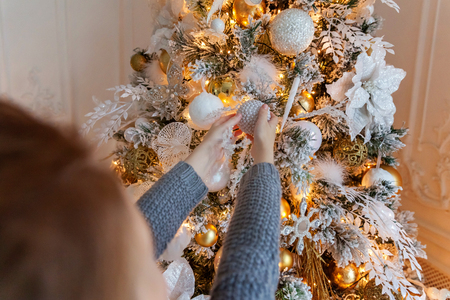 Young girl decorating Christmas tree Stock Photo