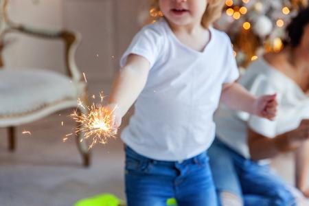young girl with Christmas sparkler