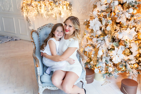 mother and daughter near a Christmas tree Stock Photo