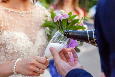 Champagne is poured into the glass