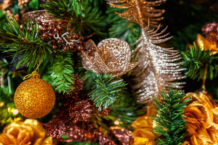 Classic christmas and New Year decorated Christmas tree with gold and black decorations closeup