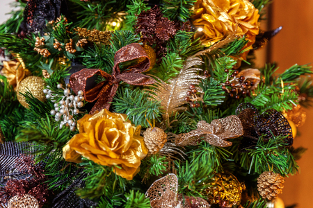 classic christmas and new year decorated christmas tree with gold and black decorations closeup stock photo - Classic Christmas Tree Decorations