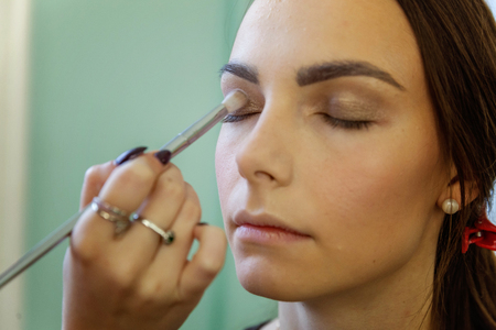 Closeup portrait of a woman having applied makeup by makeup artist Stock fotó