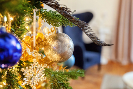 Classic christmas and New Year decorated Christmas tree with gold and blue decorations closeup