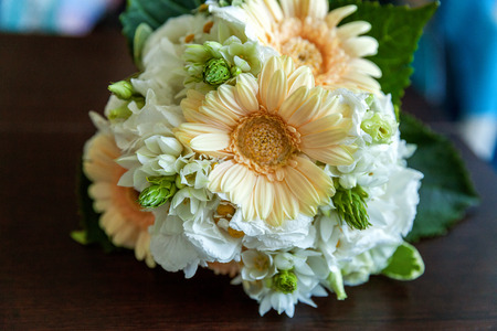 close up of gentle bouquet of the bride in pastel colors with gerbera