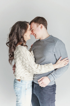 Couple in love having nice time together. Young happy woman hugging her handsome boyfriend. Cheerful casual people students having hopes, dreams, goals, bride and groom with family wants and aspirations supporting and relying each other