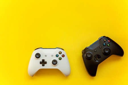 Black and white joystick on yellow background. Computer gaming competition videogame control confrontation concept
