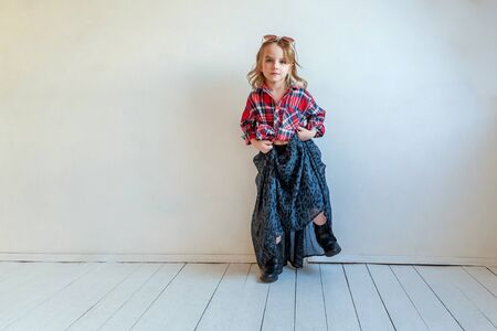 Sweet happy adorable fashion young little girl dressed like hipster hippie Stock Photo