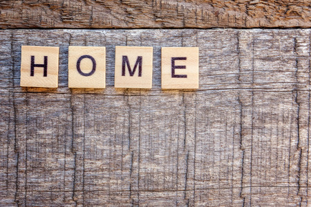 Inscription HOME letters word on old wooden backdrop. Eco Village, abstract environmental background. Real estate mortgage property insurance sweet home ecology concept. Flat lay top view copy space 写真素材