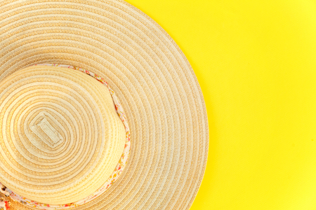 Flat Lay with striped retro hat on yellow colourful trendy modern fashion background. Vacation travel summer weekend sea adventure trip concept