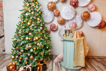 Classic christmas New Year decorated interior room New year tree. Christmas tree with gold decorations. Modern dark classical style interior design apartment. Christmas eve at home