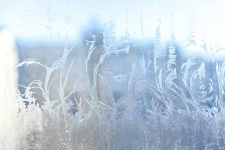 Frozen winter window with shiny ice frost pattern texture. Christmas wonder symbol, abstract background. Extreme north low temperature, natural Ice snow on frosty glass, cool winter weather outdoor