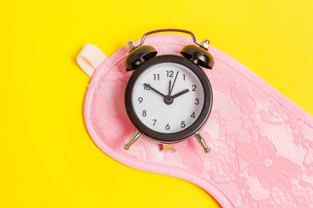 Sleeping eye mask, alarm clock isolated on yellow colourful trendy background. Do not disturb me, let me sleep. Rest, good night, siesta, insomnia, relaxation, tired, travel concept Stock fotó - 116547833
