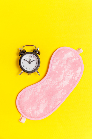 Sleeping eye mask, alarm clock isolated on yellow colourful trendy background. Do not disturb me, let me sleep. Rest, good night, siesta, insomnia, relaxation, tired, travel concept Stock fotó - 116547836
