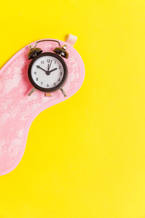 Sleeping eye mask, alarm clock isolated on yellow colourful trendy background. Do not disturb me, let me sleep. Rest, good night, siesta, insomnia, relaxation, tired, travel concept Stock fotó - 116547837