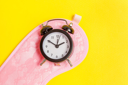 Sleeping eye mask, alarm clock isolated on yellow colourful trendy background. Do not disturb me, let me sleep. Rest, good night, siesta, insomnia, relaxation, tired, travel concept Stock fotó - 116547838