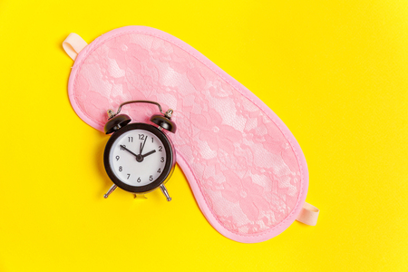 Sleeping eye mask, alarm clock isolated on yellow colourful trendy background. Do not disturb me, let me sleep. Rest, good night, siesta, insomnia, relaxation, tired, travel concept Stock fotó - 116547843