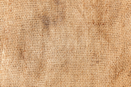 Pastel abstract Hessian or sackcloth burlap woven fabric texture. Wallpaper of artistic wale linen canvas. Blanket or Curtain of cotton pattern background in yellow beige cream sepia brown color. Copy space